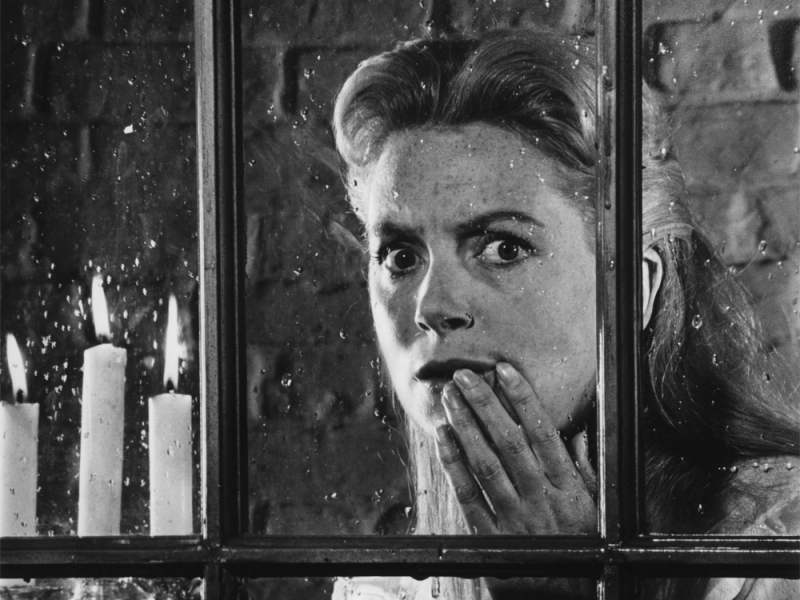 Innocents-1961-deborah-kerr-at-window-with-candles-00n-67w-1000x750